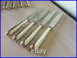 12 couteaux de table Christofle modèle Perles avec écrin en métal argenté