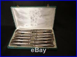 12 couteaux de table modèle louis XV, métal argenté lame inox ecrin