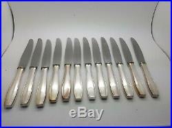 12 grands couteaux de table Christofle métal argenté modèle Atlas