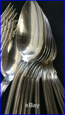 22 grand couverts en métal argenté modèle au Filet. Au bon marché Paris