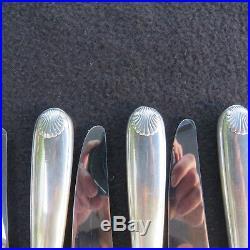 CHRISTOFLE 12 couteaux à entremet en métal argenté modèle coquille vendome