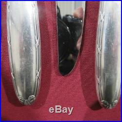 CHRISTOFLE 12 couteaux à entremet en métal argenté modèle rubans