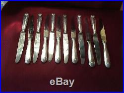 CHRISTOFLE 12 couteaux à entremets en métal argenté modèle coquille vendôme