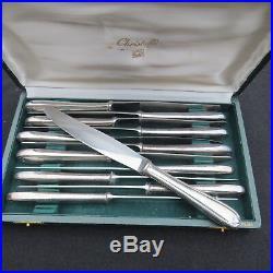 CHRISTOFLE 12 couteaux de table en métal argenté modèle coquille bérain + ecrin