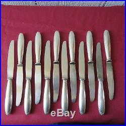 CHRISTOFLE 12 couteaux de table en métal argenté modèle rubans 2