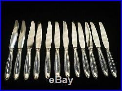 CHRISTOFLE PARIS MODELE RUBAN, 12 couteaux de table, métal argenté