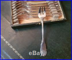 Christofle 12 fourchettes à huitre modèle Vendôme (coquille) métal argenté