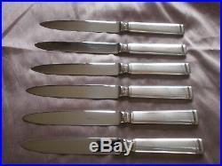 ERCUIS 12 couteaux de table en métal argenté Modèle NIL Rare