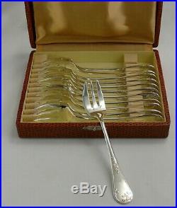 Ercuis modèle au gui 12 fourchettes à huitres excellent état métal argenté écrin