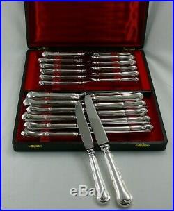 Ravinet d'Enfert, 24 couteaux modèle filet violoné, métal argenté, état neuf