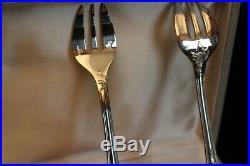 Suite de 12 fourchettes à huître en métal argenté signé Christofle modèle Marly