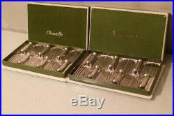 Suite de 12 porte-couteaux en métal argenté signé CHRISTOFLE modèle raquette